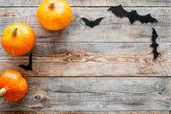 Halloween background. Pumpkins and paper bats on wooden background top view copyspace. Halloween background. Pumpkins and paper bats on wooden background top Stock Images