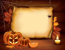 Halloween background with pumpkins, paper, candle Stock Images