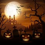 Halloween background with pumpkins and scary church on graveyard Royalty Free Stock Image