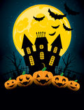 Halloween Background. A halloween background with pumpkins and a scary mansion Stock Image