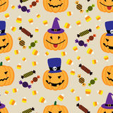Halloween background with pumpkins and sweets. Seamless pattern. Vector illustration Stock Photography