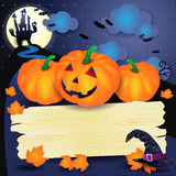 Halloween background with pumpkins and wooden sign Stock Image