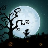 Halloween background with scary scarecrow on the full moon Royalty Free Stock Image