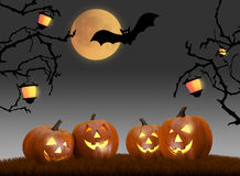 Halloween background scene with full moon, pumpkins and bats Royalty Free Stock Photography