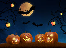 Halloween background scene with full moon, pumpkins and bats Royalty Free Stock Images