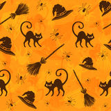 Halloween background. Halloween seamless pattern with cats, brooms and witch hats Stock Images