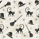 Halloween background. Halloween seamless pattern with cats, brooms and witch hats Stock Photos