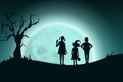 Halloween background with silhouette of children standing on landscape  Royalty Free Stock Images