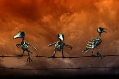 Halloween background. Skeleton birds. Orange sky background. Royalty Free Stock Photos