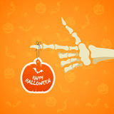 Halloween background with skeleton hand and pumpkin Stock Images