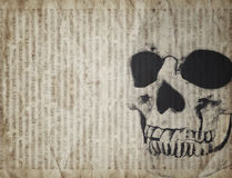 Halloween background with skull on old vintage newspaper Royalty Free Stock Photo
