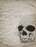 Halloween background with skull on old vintage newspaper. Halloween background with human skull on old vintage newspaper stock photos