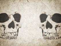 Halloween background with skull on old vintage paper. Halloween background with human skull on old vintage paper royalty free stock photos