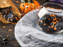 Halloween background with spider net and orange confetti Royalty Free Stock Photos