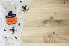 Halloween background. Spider web, spiders and smiling jack decorations as symbols of Halloween Stock Images