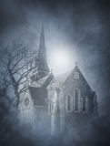 Halloween background with a spooky castle on the mountain Stock Image
