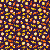 Halloween background with sweets. Seamless vector pattern. Stock Images