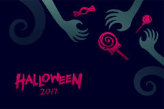 Halloween 2017 background template set, devil monster hand. With candy concept design and halloween 2017 text illustration isolated on dark blue background Royalty Free Stock Photography