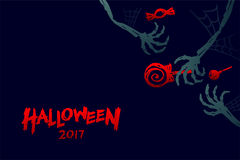 Halloween 2017 background template set, skeleton monster hand. With candy concept design and halloween 2017 text illustration isolated on dark blue background Stock Image