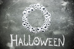 Halloween background with toy eyeballs frame. On a dark stone background Royalty Free Stock Photography