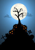 Halloween background with tree grave and pumpkins Royalty Free Stock Images
