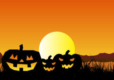 Halloween Background. Vector illustration of Halloween background with  pumpkins, the yellow moon and the orange sky Stock Images