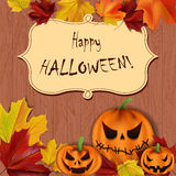 Halloween background. Vector Halloween background with scary pumpkins and leaves on wooden surface Royalty Free Stock Photo