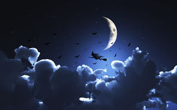 Halloween background with witch flying through a moonlit sky Stock Photography