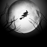 Halloween background with witch flying in the sky Stock Photo