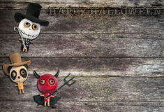Halloween. Background , wooden ghost dolls on old wooden background Stock Image