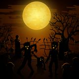 Halloween background with zombies, tombstones and the moon on the cemetery Stock Photo