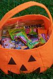Halloween bag with different sweets stock images