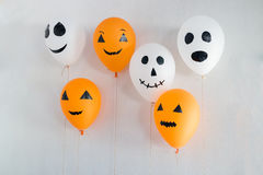 Halloween balloons decorated on white Royalty Free Stock Images