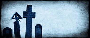 Halloween banner with old paper texture and medieval stone cross. Es, tombstones in a cemetery. Toned in blue color. Copy space for your text Stock Photo