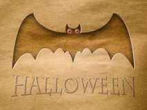 Halloween bat on old brown paper Stock Images