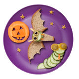 Halloween bat and snake made of bread and cucumber Stock Images