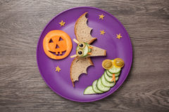 Halloween bat and snake made of bread and cucumber Stock Image