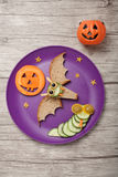Halloween bat and snake made of bread and cucumber Royalty Free Stock Photography