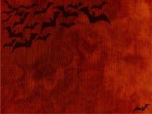 Halloween batte il nero sul fondo arancio del cielo fotografia stock