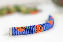 Halloween beaded bracelet with images of pumpkins Stock Images