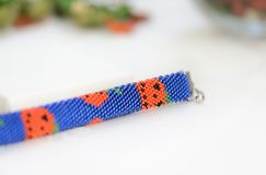 Halloween beaded bracelet with images of pumpkins Royalty Free Stock Photos