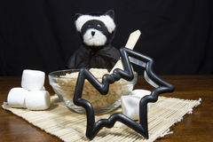 Halloween Bear Making Bat Shaped Cookies Stock Photo