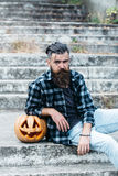 Halloween bearded man with pumpkin stock photos