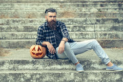 Halloween bearded man with pumpkin Royalty Free Stock Image