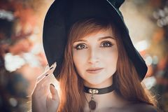 Free Halloween Beautiful Young Witch Girl In Witches Hat Royalty Free Stock Photography - 161437587