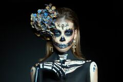 Halloween beauty skeleton woman makeup face. Girl death Halloween costume. Day of The Dead. Charming and dangerous Calavera