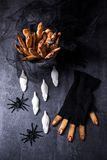 Halloween biscuit finger and cake coffin Stock Photography