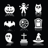 Halloween black icons set - pumpkin, witch, ghost on black. Scary white icons set for Halloween party  on black background Stock Photos
