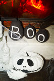 Halloween black and white pumpkin head jack over fireplace Stock Image