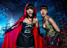 Halloween. Bloodthirsty Vampire Beautiful Woman. In the dungeon Royalty Free Stock Photos